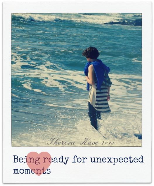 Girl getting wet by waves, girl standing in ocean water, Theresa Huse 2013-03249
