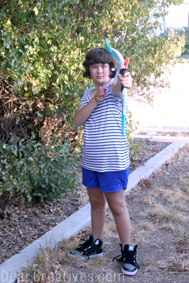 Girl Holding Nerf Rebelle, Girl holding bow and arrow toy, Theresa Huse 2013