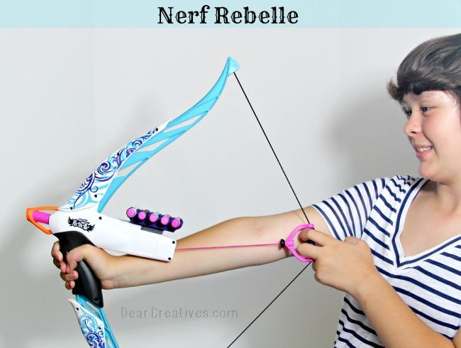 Nerf Rebelle, Girl holding Nerf Rebelle, Girl holding arrow toy, Theresa Huse 2013