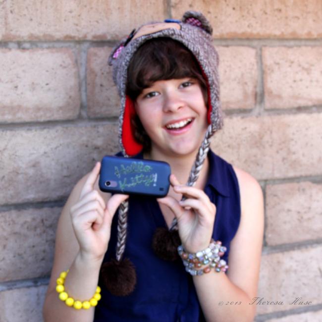 #FamilyMobileSaves_#cbias_#shop_Girl with phone, Hello Kitty decal, Theresa Huse 2013