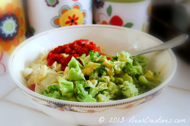 Bowl of broccoli and cheese_artichoke hearts_ red bell peppers_ Theresa Huse 2013