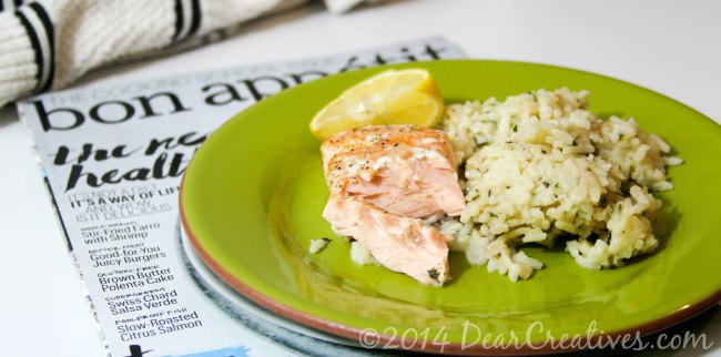 Salmon and rice on a plate sitting on bon appetit magainze