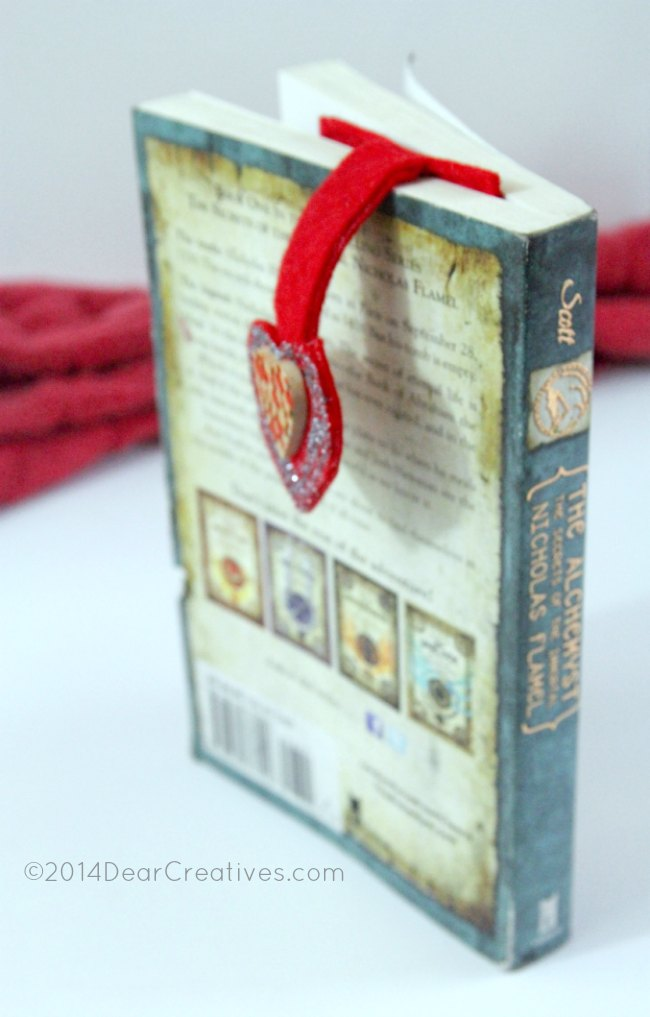 Felt handmade Bookmark in a book_