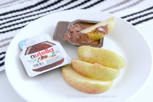 Nutella and apples on a plate_ apple dipped in Nutella