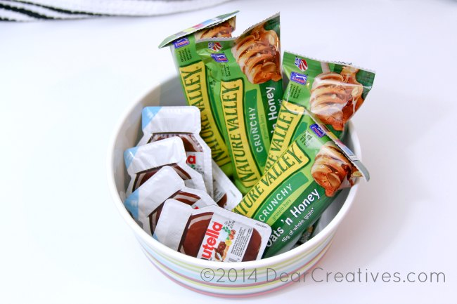 bowl with nutella packets and nature valley granola bars_