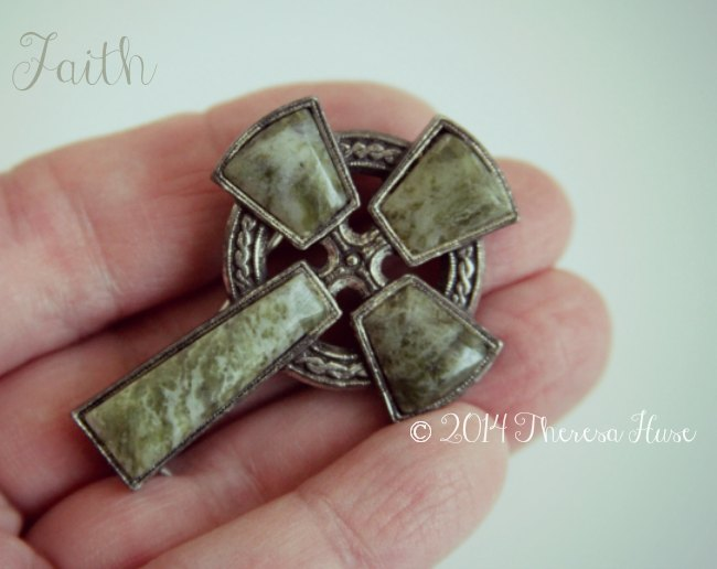 Cross being held in a hand_faith_
