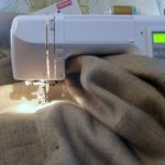 Sewing Machine with burlap being sewn for a tablecloth
