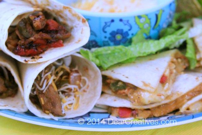 close up of steak fajitas and chicken quesadillas _