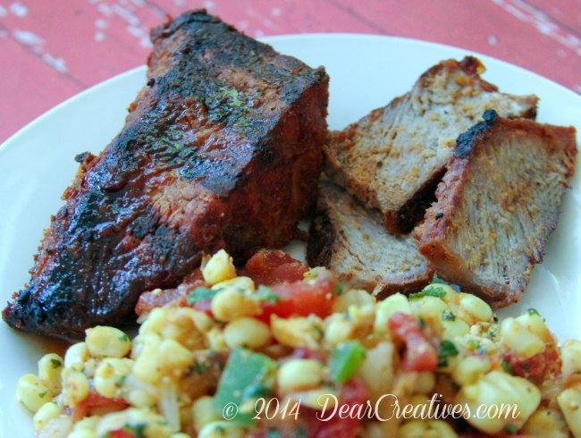 teak and steak slices with corn salsa on a plate_