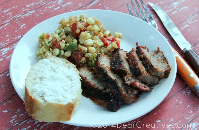 Corn Salsa on a plate with steak and bread