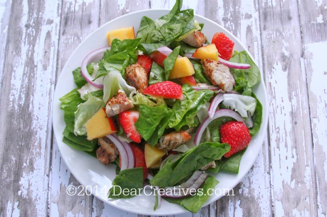 grilled chicken salad with strawberries - First grill your chicken, make the salad add the grilled chicken, fruits, and homemade ginger dressing. Easy to grill and make for a bbq or picnic