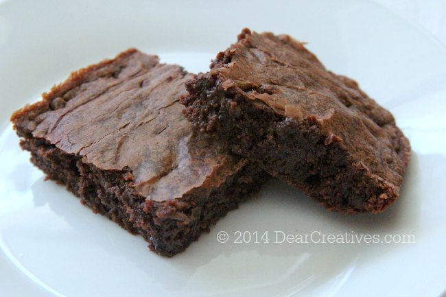 Brownies on a plate_ two brownies on a white plate_