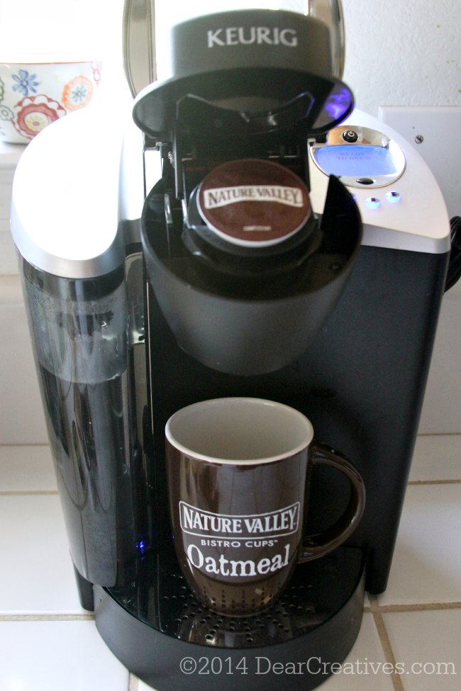 Keurig coffee maker with a Nature Valley K cup in it ready to brew_