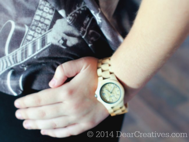 Wearing a watch_ hand on hip_