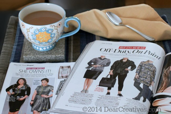 Magazines and coffee on a table_