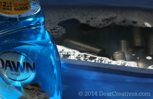 Sockets soaking in water with Dawn Dish washing liquid_