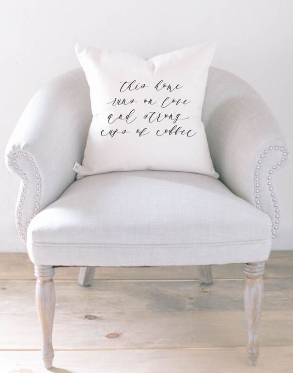 This Home Runs on Love And Strong Cups of Coffee - Coffee Saying On A Pillow On A Chair - Find more coffee art and coffee pillow designs.
