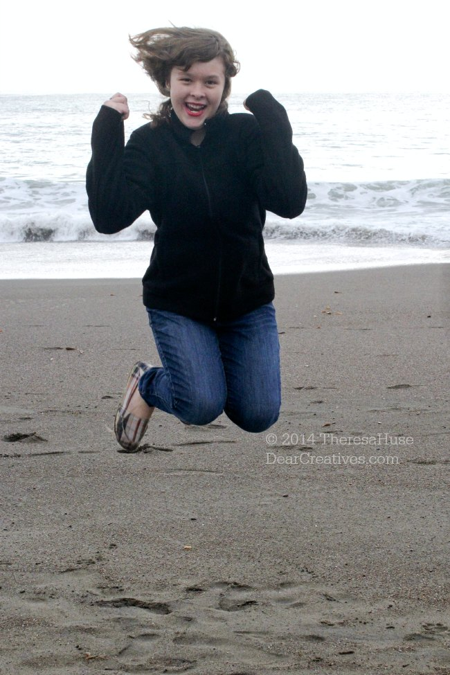 Girl Jumping for Joy at the beach_