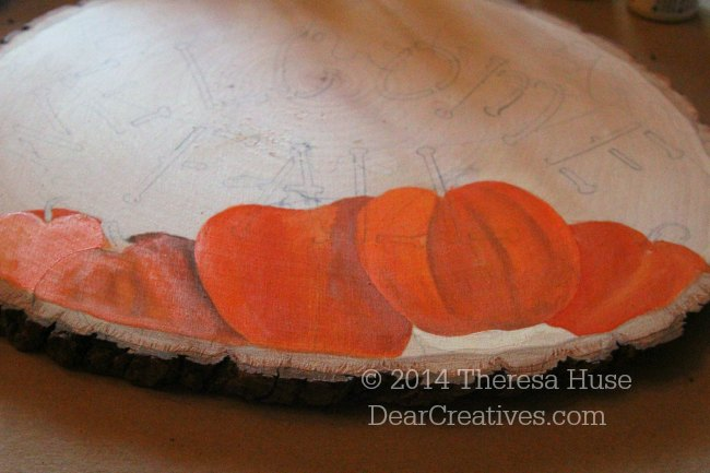 Sketched out design and beginning painting of welcome fall sign with pumpkins_