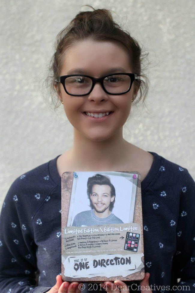 Young Lady holding One Direction Limited Edition Holiday Makeup Kit_© 2014 DearCreatives.com_