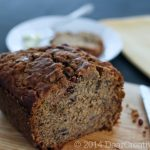 Banana Bread a knife on a cutting board with a slice of banana bread on a plate with butter_banana bread_© 2014 Theresa Huse_ DearCreatives.com