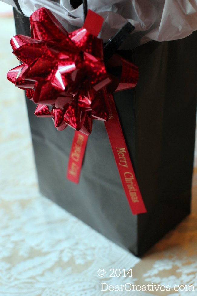 Holiday packaging_gift bag with bow and ribbon with a message_© 2014 DearCreatives.com