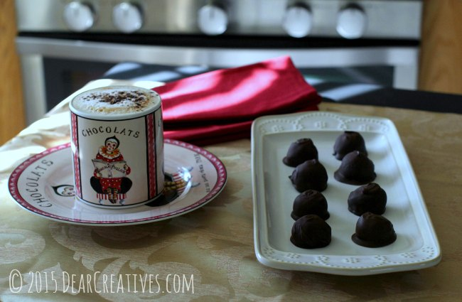 Chocolate Covered Cherries on a ceramic platter with a latte on a table_Chocolate Covered Cherries_