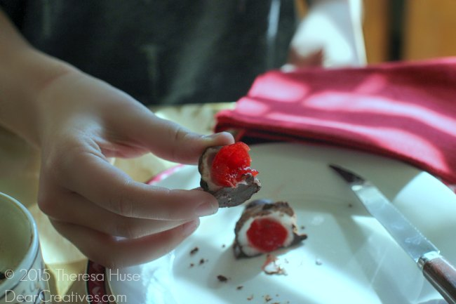 Holding a Chocolate Covered Cherry_
