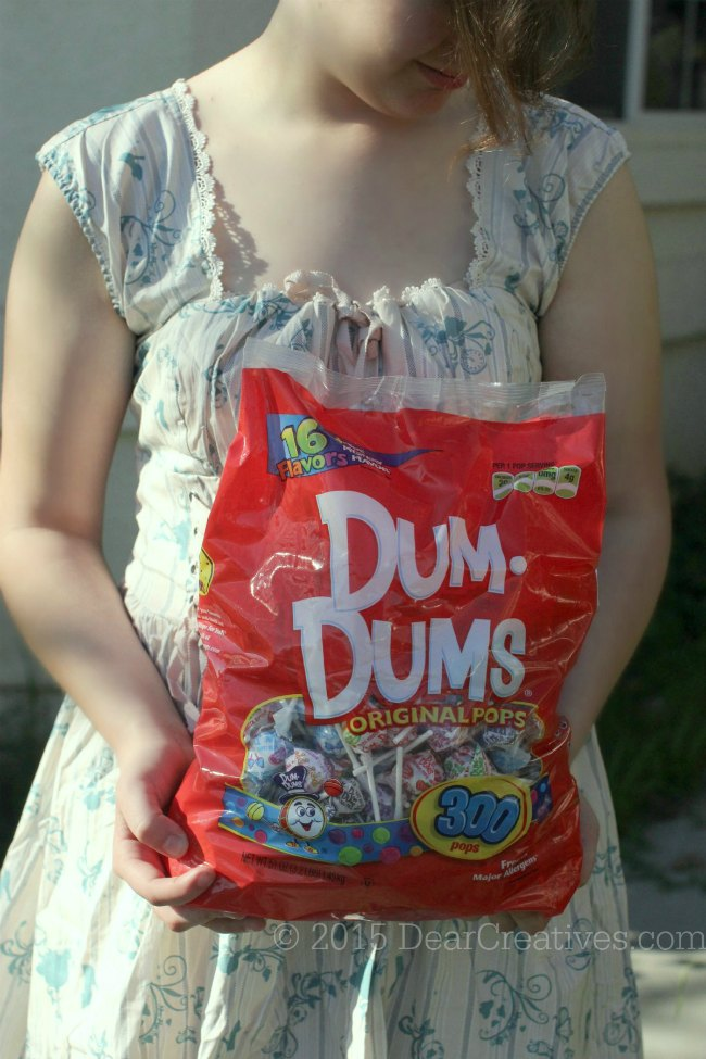 Spring Crafts Ideas | girl with bag of dum dum lollipops #TheMagicOfSpring