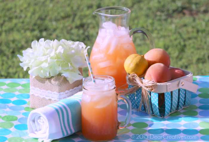Homemade Peach Strawberry Lemonade outside on a picnic table _2