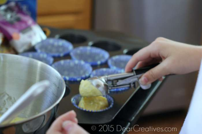 scooping cornbread mix into cupcake tins