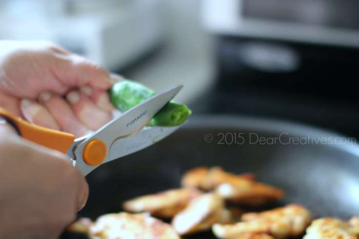 Cutting a jalapeno with all purpose kitchen shears