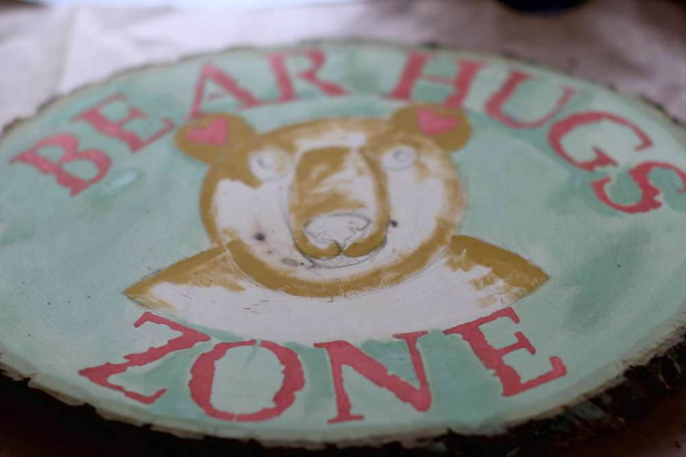 Finished Stenciling and add heart ears then touch up with mint julep green. Steps for how to paint and stencil a bear sign for a kids playroom, kid's room or nursery. DearCreatives.com