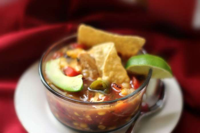 homemade soup   chicken tortilla soup with corn close up