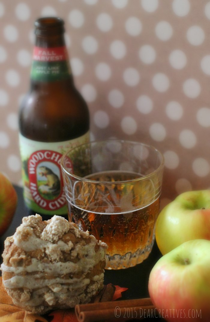 WoodChuck Hard Cider in a glass next to an apple muffin