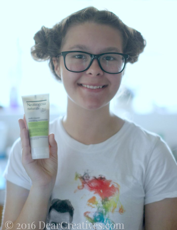 Natural Beauty Tips Neutrogena Naturals Young lady holding moisturizer lotion