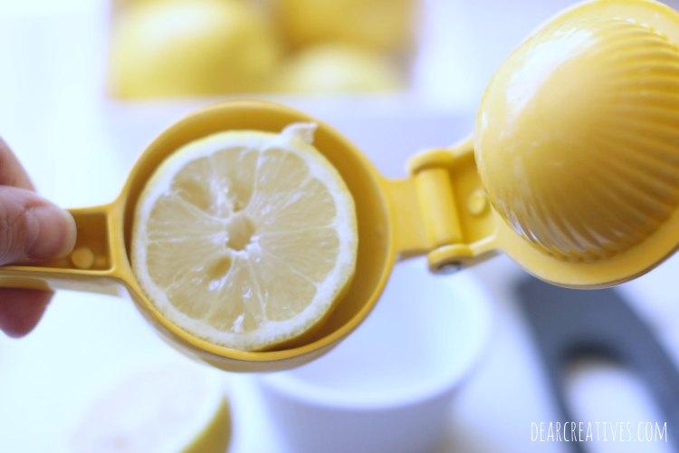 lemons squeezing a lemon for homemade lemonade