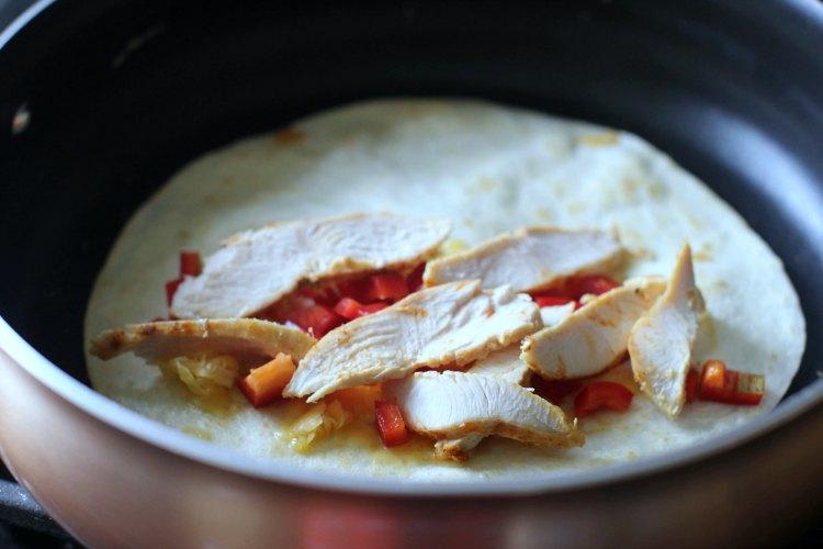 in the kithen- kitchen tools-cooking © 2017 Theresa Huse cooking a chicken quesadilla
