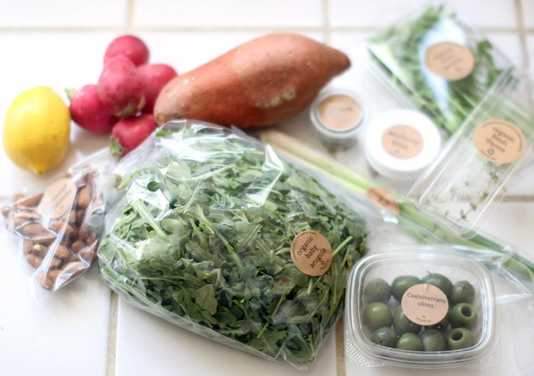 Review Sun Basket Meal Kit Delivery Review DearCreatives.com meal kit contents vegetables, green olives, almonds and herb for a Sun Basket meal kit recipe