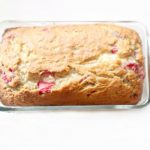 Strawberry Bread Recipe DearCreatives.com Strawberry Banana Bread in a baking dish cooling after being baked. You'll love this easy baking recipe and makes a great treat.