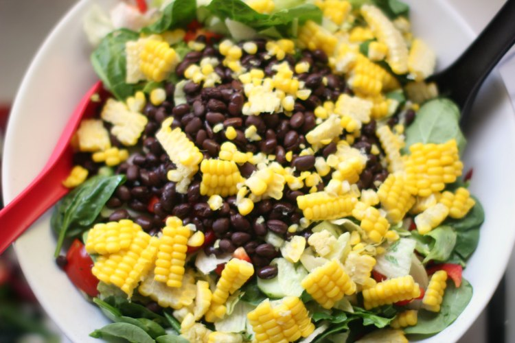 Next add the fresh corn kernels onto your salad. Southwest Salad Recipe- DearCreatives.com