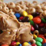 Cheerios, peanut butter and M & M's candy in a bowl for a cereal bar recipe