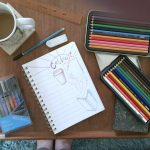 coloring and journaling at the coffee table