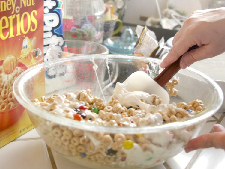 making cereal treats in a big mixing bowl