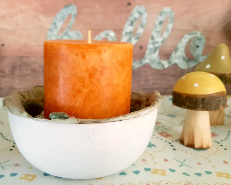 pumpkin candle in a home made cement candle holder