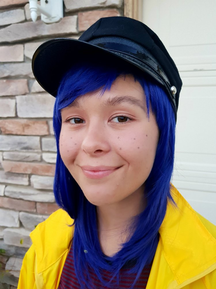 Coraline hair, hat, and makeup for an easy Coraline Costume. See full DIY at DearCreatives.com