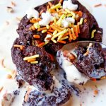 chocolate gooey yummy cookie stuffed with ice cream cut into with a spoon, treat idea see how to make this at DearCreatives.com