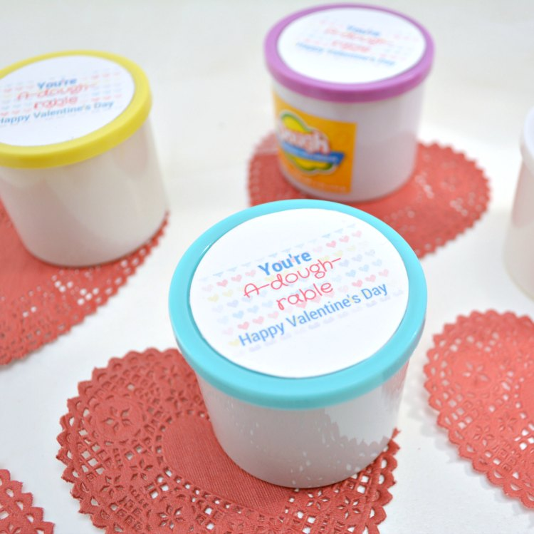 Play dough with Valentine's Day printable on top of lid