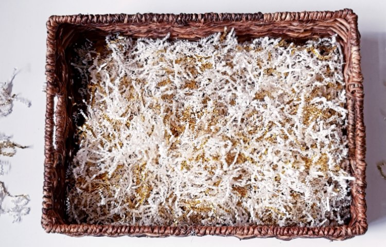 basket with shredded crinkle paper for gifts