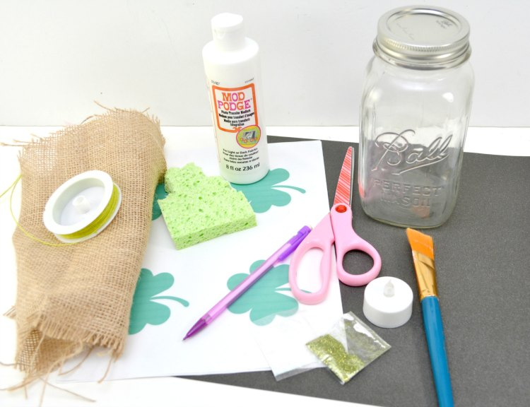 craft supplies for making a frosted luminary mason jar